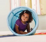 Toddler inside a toy tunnel